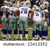 DALLAS - DEC 14: Taken in Texas Stadium on Sunday, December 14, 2008. Cowboys offense huddles before the play with the NY Giants. - stock photo