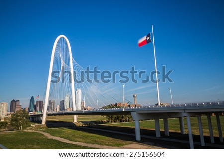 Dallas downtown skyline and Margaret hut hills bridge from Continental bridge park, Texas - stock photo