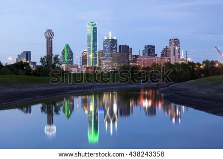 Dallas downtown skyline illuminated at night with reflection in the Trinity River. Texas, United States
