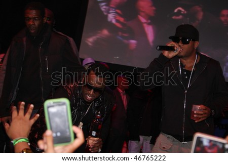 """DALLAS - FEBRUARY 12: Music mogul Sean """"Diddy"""" Combs(center) and Rapper Red Cafe(r) perform at Palladium Ballroom for a NBA All Star Weekend event February 12, 2010 in Dallas, Texas. - stock photo"""