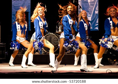 DALLAS - MAY 17.  Dallas Cowboys Cheerleaders perform routines for the American Association of Airport Executives convention held at the Cowboys Stadium on May 17, 2010 at Dallas, Texas. - stock photo