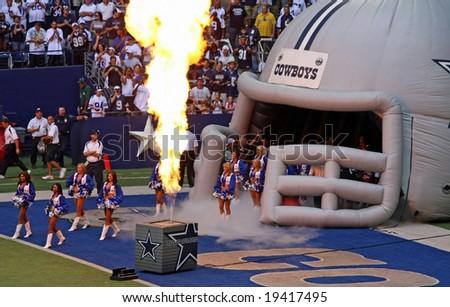 DALLAS - OCT 5: Texas Stadium Irving, Texas Sunday, October 5, 2008. Dallas Cowboys cheerleaders enter field to pyrotechnics. The last season that the Cowboys will play in Texas Stadium. - stock photo