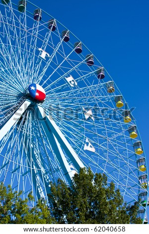 DALLAS - SEPTEMBER 30: The tallest ferris wheel in the US, The Texas Star, towers above the horizon at the State Fair of Texas September 30, 2010 in Dallas, Texas.