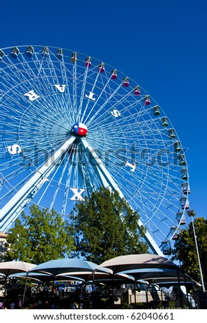 DALLAS - SEPTEMBER 30: The tallest ferris wheel in the US, The Texas Star, towers above the horizon at the State Fair of Texas September 30, 2010 in Dallas, Texas. - stock photo