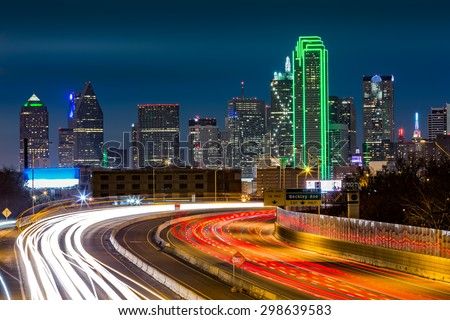 Dallas skyline by night The rush hour traffic leaves light trails on I-30 (Tom Landry) freeway.