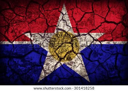 Dallas ,Texas flag pattern on crack soil texture,retro vintage style - stock photo