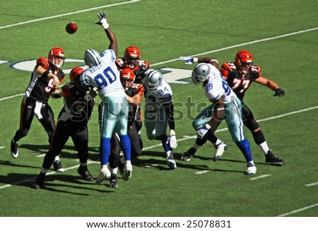 DALLAS, TEXAS - OCT 5: Cincinnati Bengals quarterback Palmer passes the football against the Dallas Cowboys defense during a game at Texas Stadium, Irving, Texas on October 5, 2008.