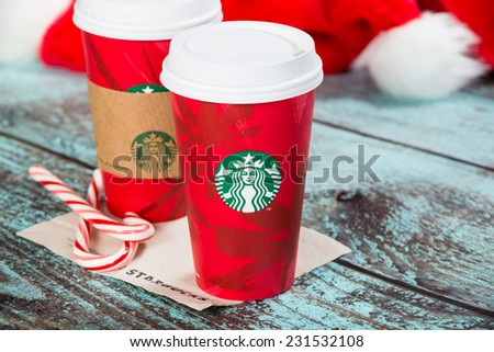 DALLAS, TX - NOVEMBER 18, 2014: A cup of Starbucks popular holiday beverage, peppermint mocha, displayed with candy canes on wooden table.  - stock photo