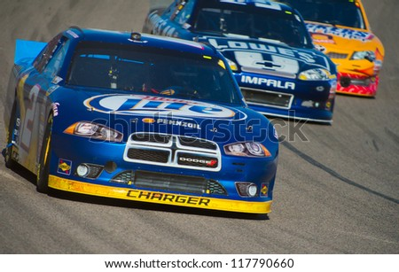 DALLAS, TX - NOVEMBER 04: Brad Keselowski 2, is chased by jimmie Johnson 48 and Kyle Busch 18 at th Nascar Sprint Cup AAA Texas 500 at Texas Motorspeedway in Dallas, TX on November 04, 2012 - stock photo