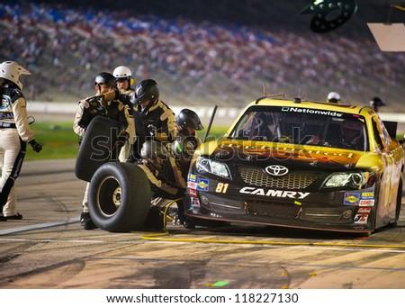 DALLAS, TX - NOVEMBER 03: Jason Bowles during a pit stop at the Nascar Nationwide Race at Texas Motorspeedway in Dallas, TX on November 03, 2012 - stock photo