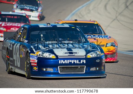 DALLAS, TX - NOVEMBER 04: Jimmie Johnson 48 followed by Kyle Busch 18 in turn 4 at the Nascar Sprint Cup AAA Texas 500 at Texas Motorspeedway in Dallas, TX on November 04, 2012 - stock photo