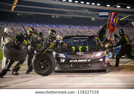 DALLAS, TX - NOVEMBER 03: Kyle Busch during a pit stop at the Nascar Nationwide Race at Texas Motorspeedway in Dallas, TX on November 03, 2012 - stock photo