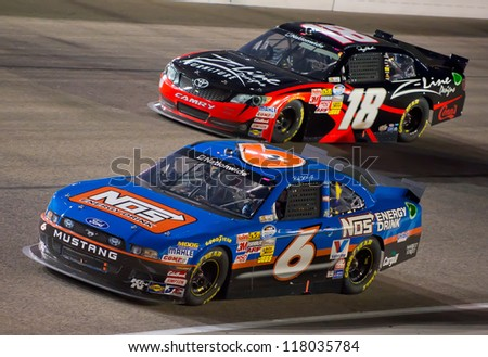 DALLAS, TX - NOVEMBER 03: Ricky Stenhouse Jr 6 passing Denny Hamlin 18 during the Nascar Nationwide Race at Texas Motorspeedway in Dallas, TX on November 03, 2012 - stock photo