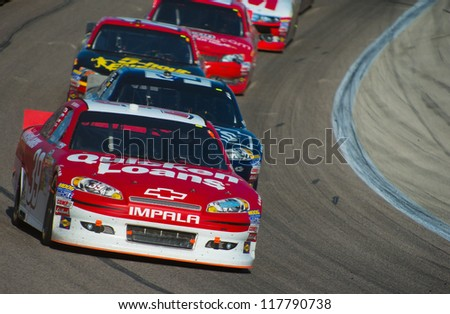 DALLAS, TX - NOVEMBER 04: Ryan Newman 39 leads Jimmie Johnson 48 and Clint Bowyer 15 around turn 1 at the Nascar Sprint Cup AAA Texas 500 at Texas Motorspeedway in Dallas, TX on November 04, 2012