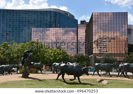 DALLAS, TX - SEP 17: The Cattle Drive Sculpture at Pioneer Plaza in Dallas, Texas, as seen on Sep 17, 2016. The 49 bronze steers and 3 trail riders sculptures were created by artist Robert Summers.