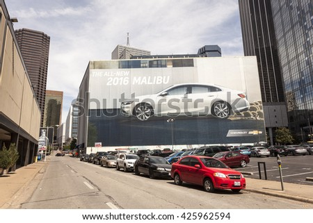 DALLAS, USA - APR 7, 2016: The New Chevrolet Malibu commercial on a building downtown in Dallas. Texas, United States - stock photo