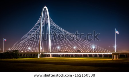 DALLAS, USA - OCTOBER 23: Margaret Hunt Hill bridge by night on October 23, 2013 in Dallas, USA. Margaret Hunt Hill Bridge is a Santiago Calatrava-designed bridge built over the Trinity River. - stock photo