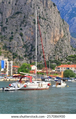 Dalmatian coast with small bay and harbor surrounded by steep mountains, Omis, Croatia