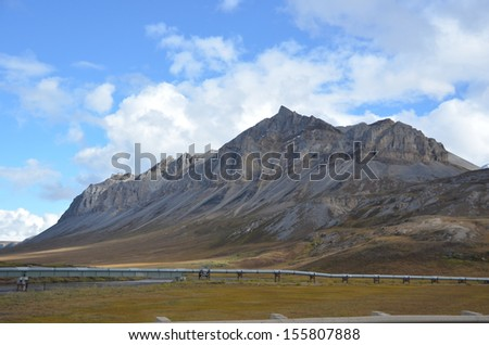 Dalton Highway Oil Pipeline with Mountain, Alaska - stock photo