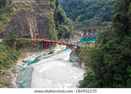 dam and red bridge - stock photo
