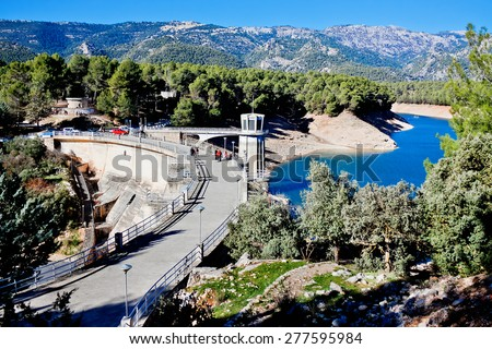 Dam and reservoir at Guadalentin river. Andalusia, Spain  - stock photo