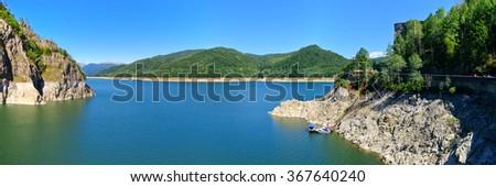 Dam lake Vidraru in Romania - stock photo