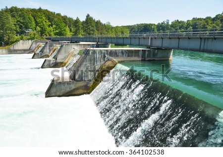 Dam of power sation across Rhine river - stock photo