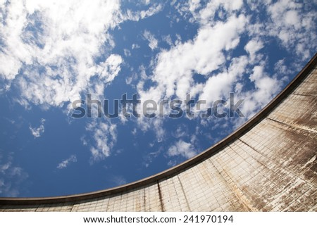 Dam wall against the sky - stock photo