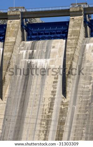 dam with blue sluice - stock photo
