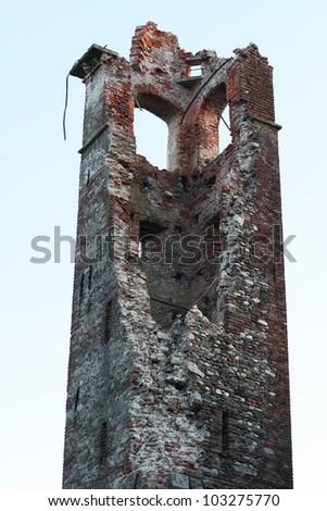 Damaged ancient X century building Pieve di Suno, Italy - stock photo
