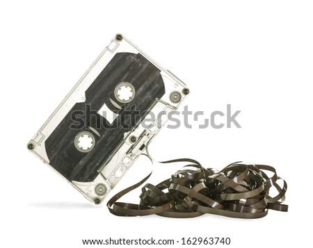 Damaged audio cassette  isolated on white background - stock photo