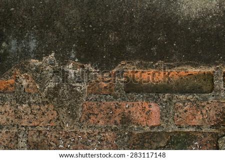 damaged brick wall  - stock photo
