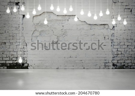 damaged brick wall with bulbs - stock photo