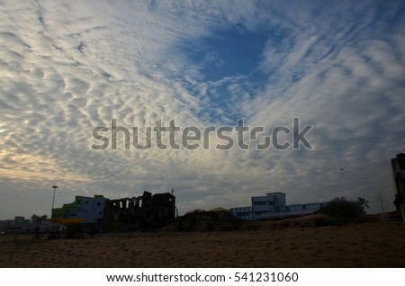 Damaged building under the beautiful cloudy sky.