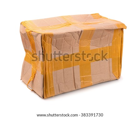 Damaged cardboard box isolated on white - stock photo
