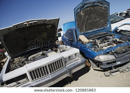 Damaged cars in junkyard