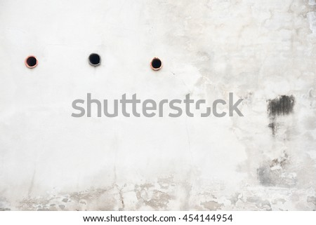 damaged concrete wall, cracked brick wall texture, It is hole on the wall - stock photo