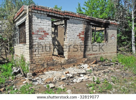Damaged construction after a fire - stock photo