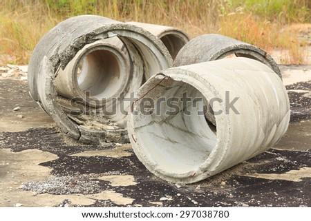 Damaged drainage pipes, concrete - stock photo