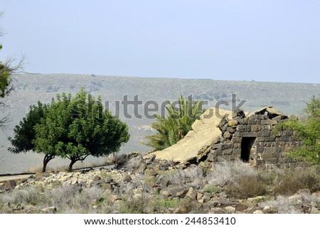 Damaged house in Umm el Kanatir site, Golan Heights. - stock photo