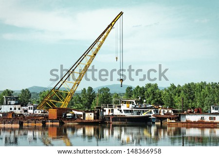 Damaged industrial boats at the bay outdoors - stock photo