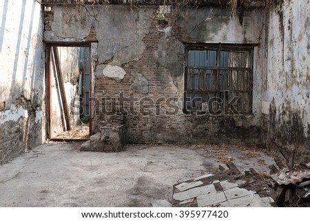 Damaged interior of abandoned house.