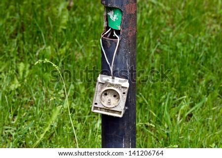 Damaged plug-220V - stock photo