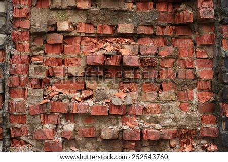 Damaged red brick background - stock photo
