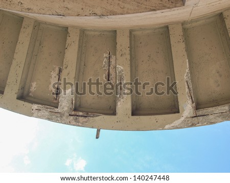 Damaged reinforced concrete structure with visible reinforcement bars