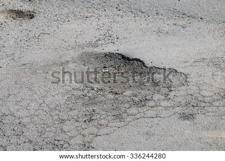 Damaged road in countryside