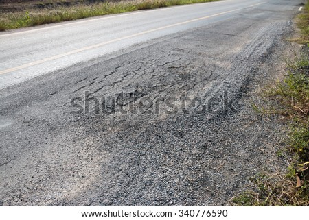 Damaged road in countryside  - stock photo