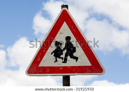damaged road sign for crossing children - stock photo