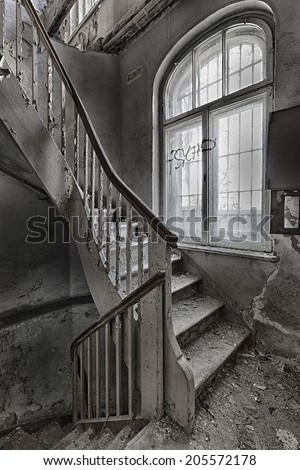 Damaged stairs in the building of the old Masonic headquarters in Gdansk, Poland - stock photo
