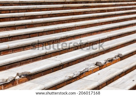Damaged steps on a bright sunny day as a background - stock photo